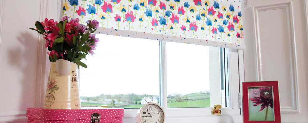 Colourful blind with flowers, clock and photo frame