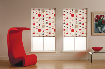 Red chair with two blinds in windows