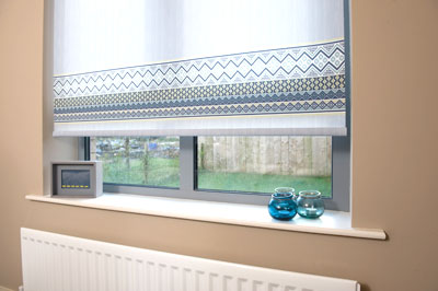 Roller blind in window