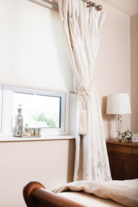 Curtains, bed and lamp